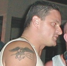 the navy seal tattoo he got on his arm